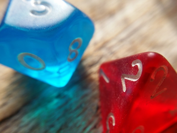 two, eight-sided dice on a table